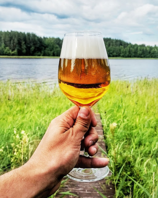 a beer at Usma lake in Latvia