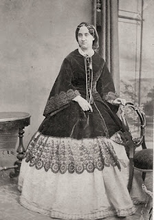 19th century photo of woman in velvet jacket with deep lace trim