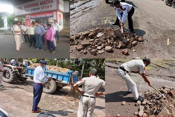 faridabad-traffic-police-fill-road-holes-sector-25
