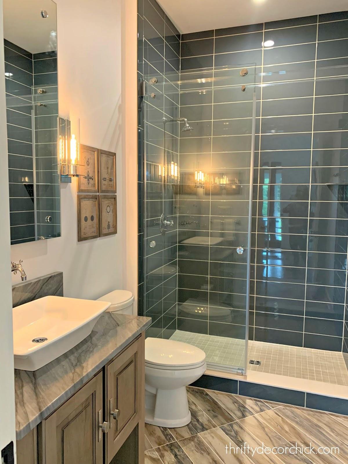 Dark blue stacked tile in shower