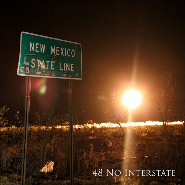 48 No Interstate back roads cross country coast-to-coast road trip Texas New Mexico state line gas flare