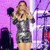 Mariah Carey dazzles in plunging metallic mini dress as she hits the stage in Quebec