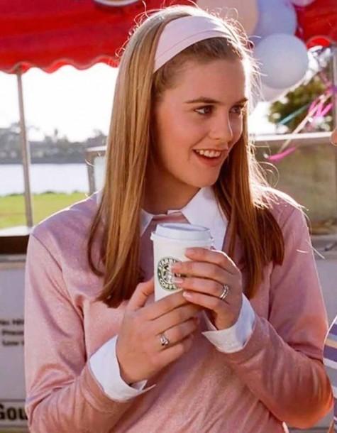 garota anos 90s usando faixa de cabelo rosa