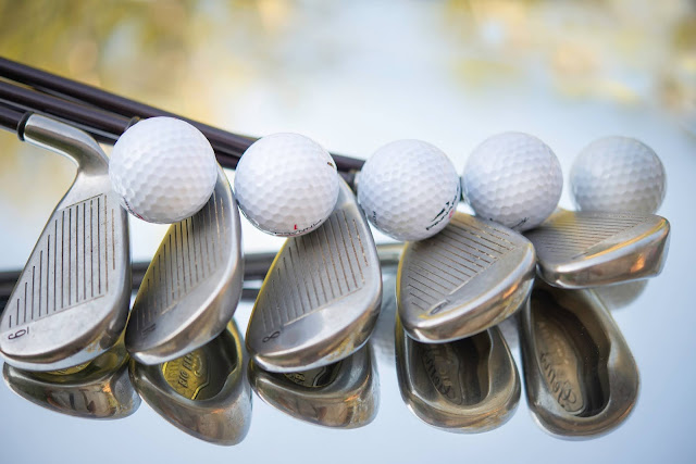 Golf clubs and balls:Photo by Cristina Anne Costello on Unsplash