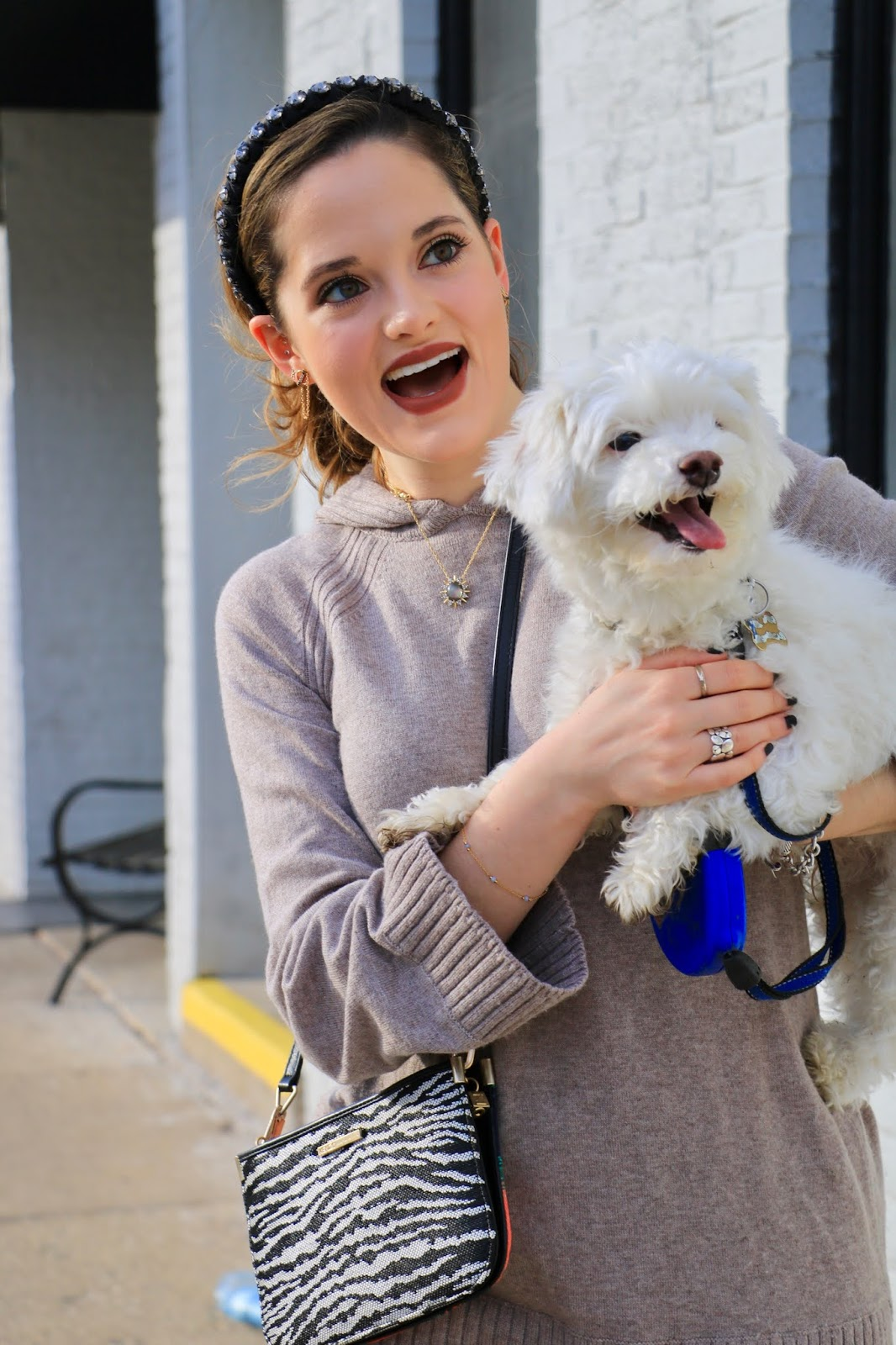 Nyc fashion blogger Kathleen Harper with her maltese bichon mix rescue dog.
