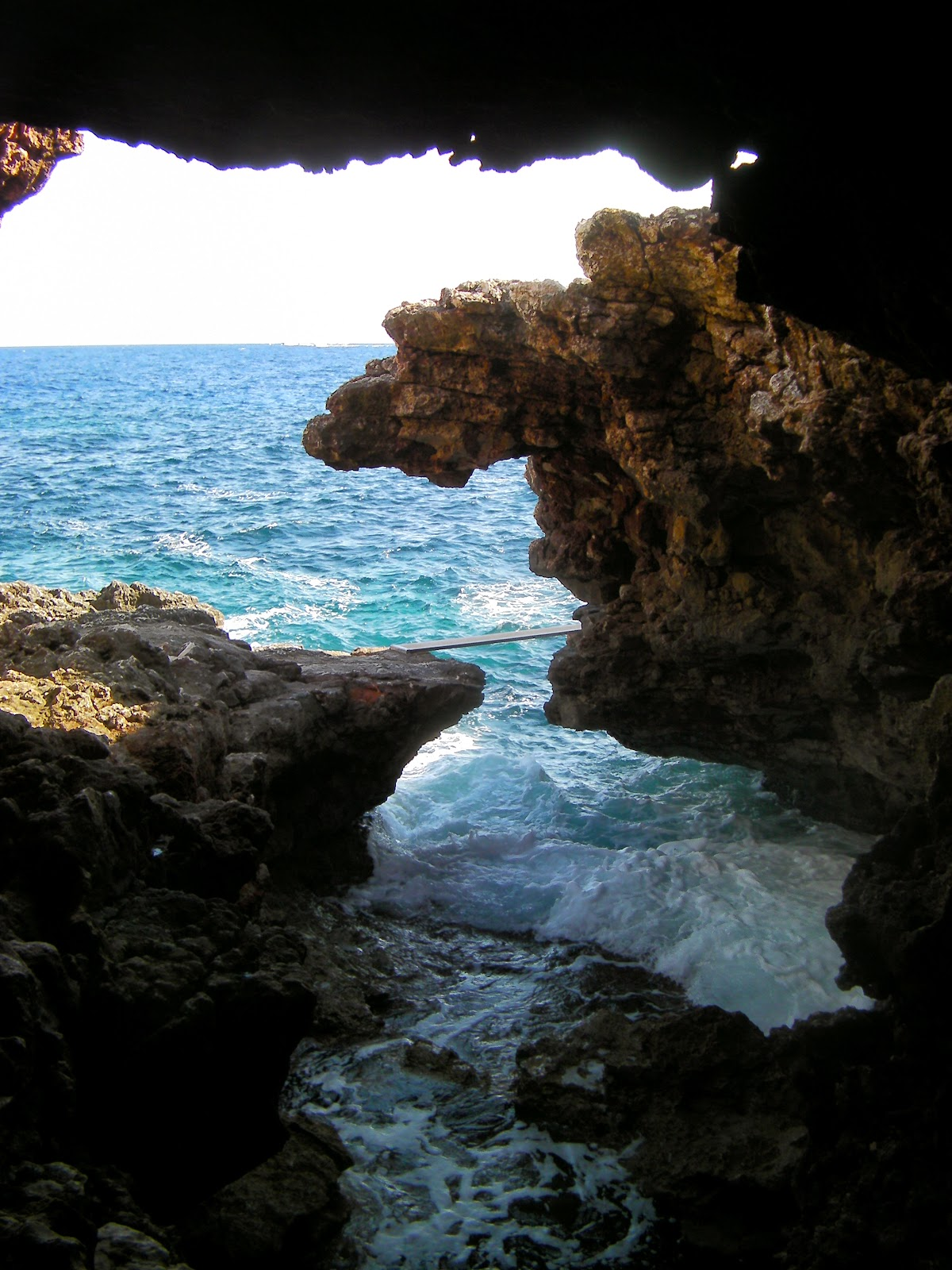 sea washing into sea cave cala barca coastline of majorca