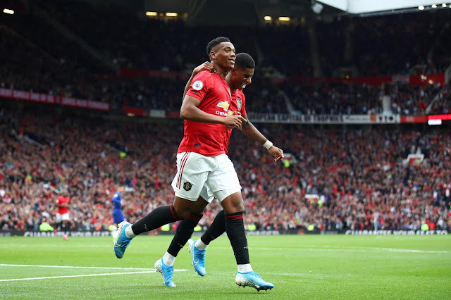 Anthony Martial and Marcus Rashford celebrates a Manchester United goal during a premier league match