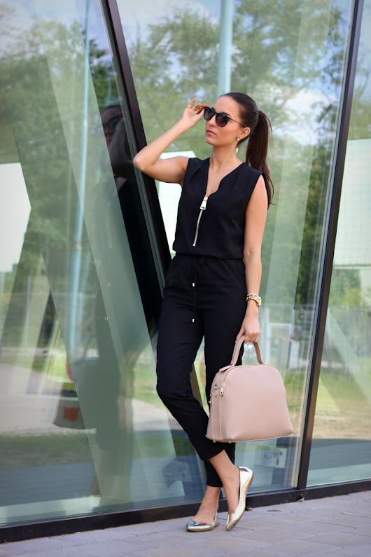 BLACK JUMPSUIT WITH SOME NUDE
