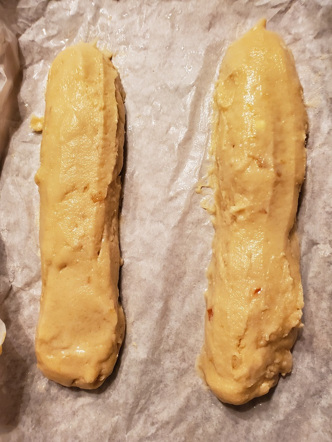 these are loaves of biscotti raw dough smooth out with water