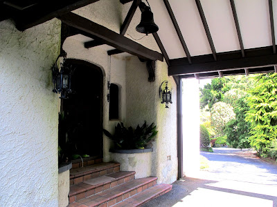 Entryway of an old arts-and-crafts-style building.