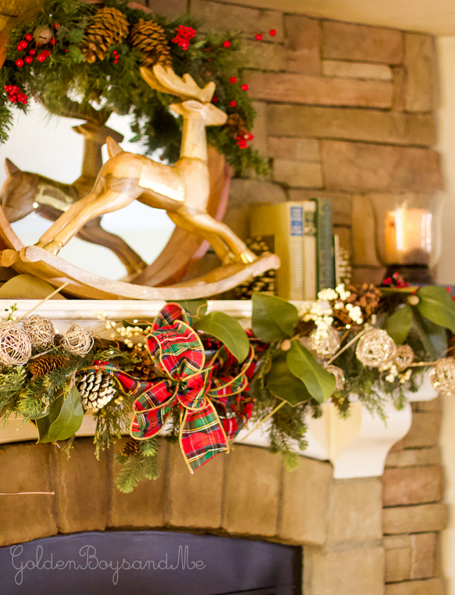 Stone fireplace with white mantel and classic plaid Christmas decor - www.goldenboysandme.com
