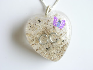 Personalised pendant for ashes containing a butterfly