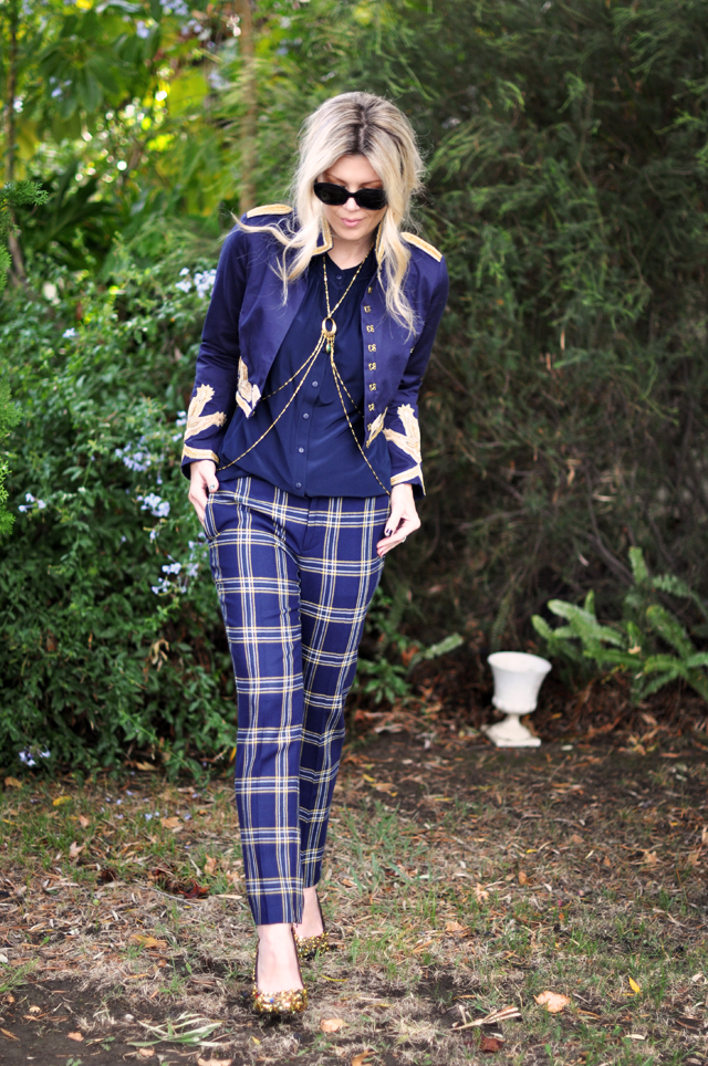 plaid pants, navy jacket with gold embroidery, body harness