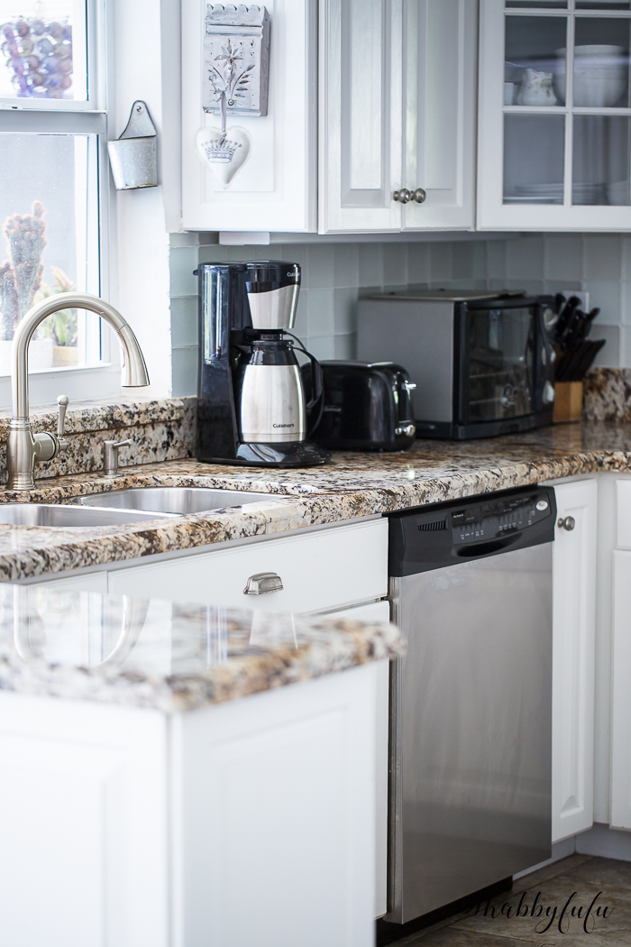 white kitchen with granite