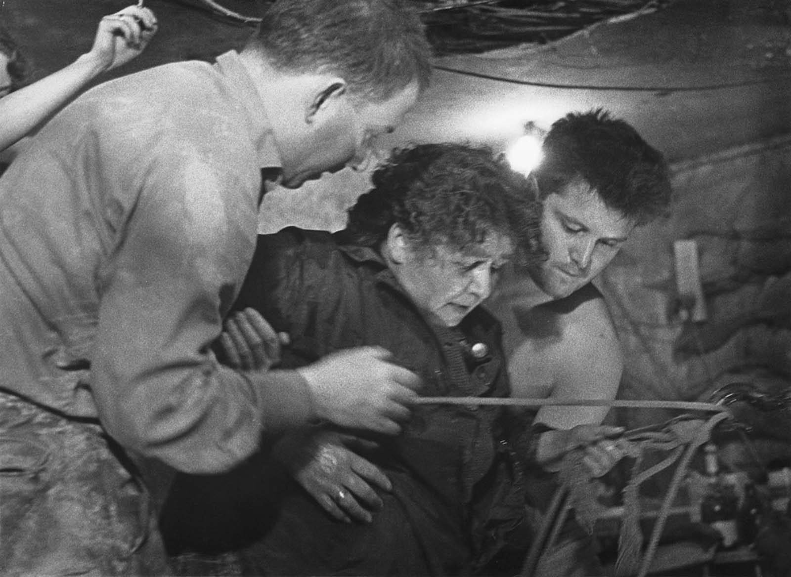 A 75-year-old woman is helped into Tunnel 57, through which 57 East Berlin citizens escaped to the western sector of the city on October 3 and 4, 1964. The tunnel was dug from West to East by a group of 20 students led by Joachim Neumann, from a disused bakery building on Bernauer Strasse, under the Berlin Wall, to a building 145 meters away on Strelitzer Strasse in East Berlin.
