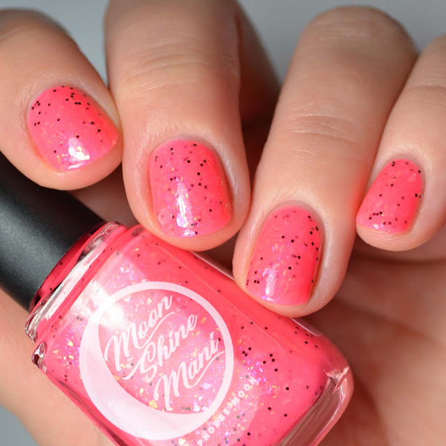 neon pink nail polish with flakies swatch