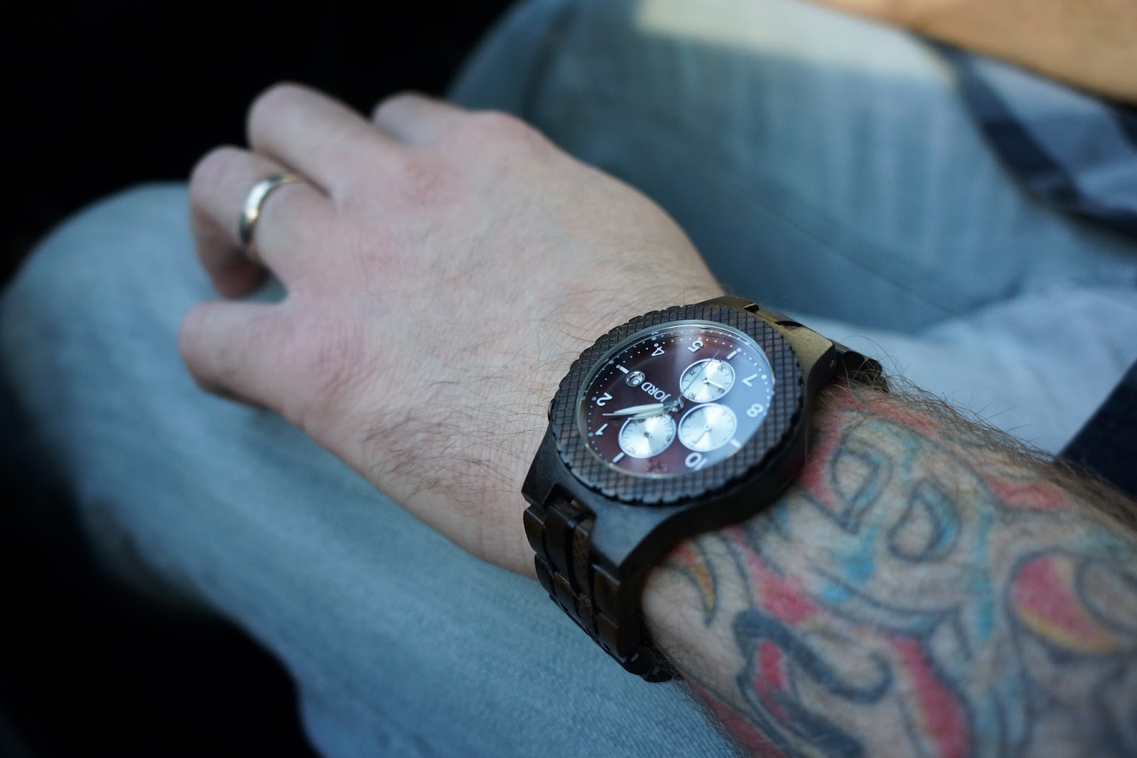 JORD men's wooden watch worn by tattooed man