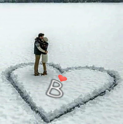 Complete Alphabet Couple Standing on Snow Letter Dpz for Facebook