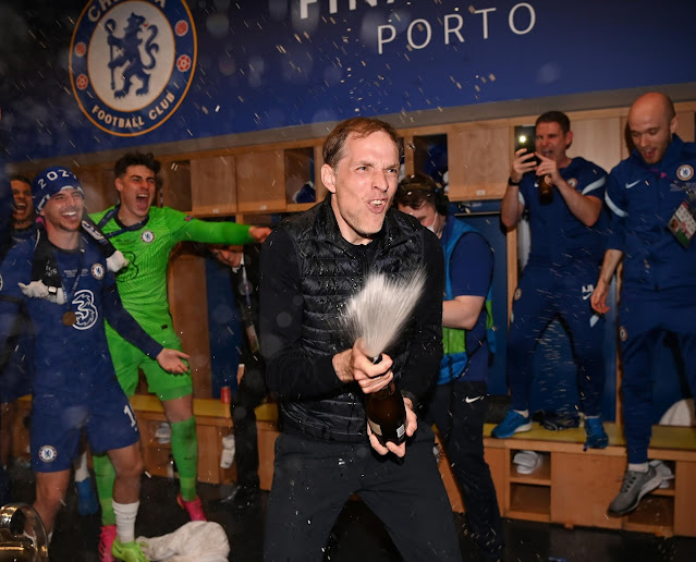 Thomas Tuchel popping champagne after Chelsea's champions league win
