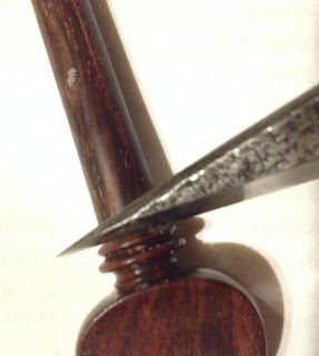 Violin peg shaving