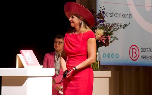 Dutch Breast Cancer Association. Queen Maxima wore a new short sleeve berry-red dress by Natan. Royal purple hat, earring Oscar de la Renta