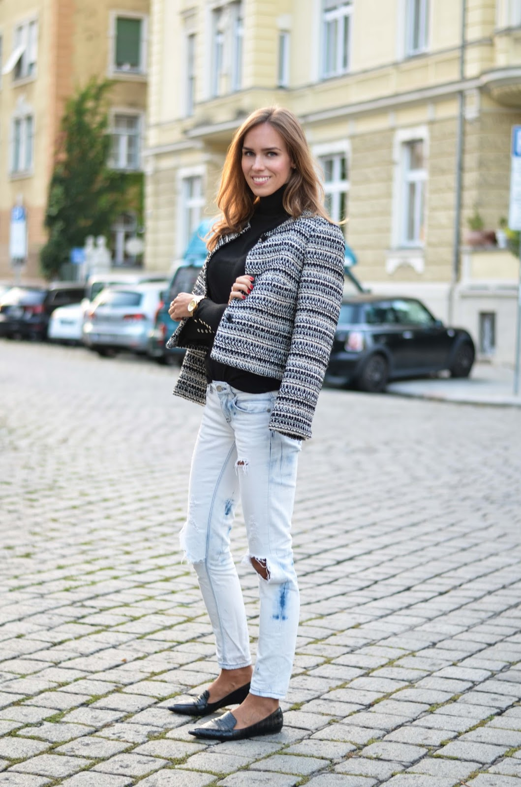 kristjaana mere black white blazer ripped jeans black jumper