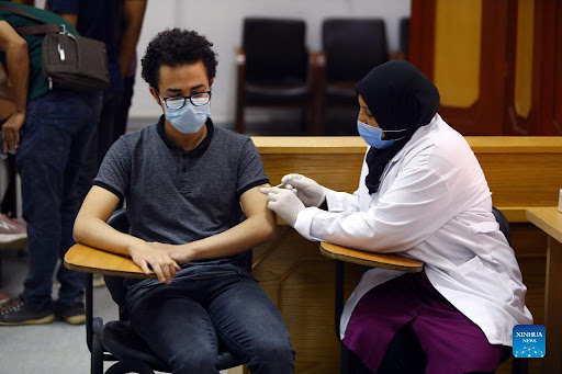 An Egyptian student receiving vaccination in Cairo
