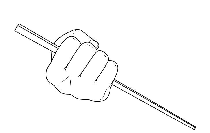 Tangan memegang sumpit dalam gambar kepalan tangan