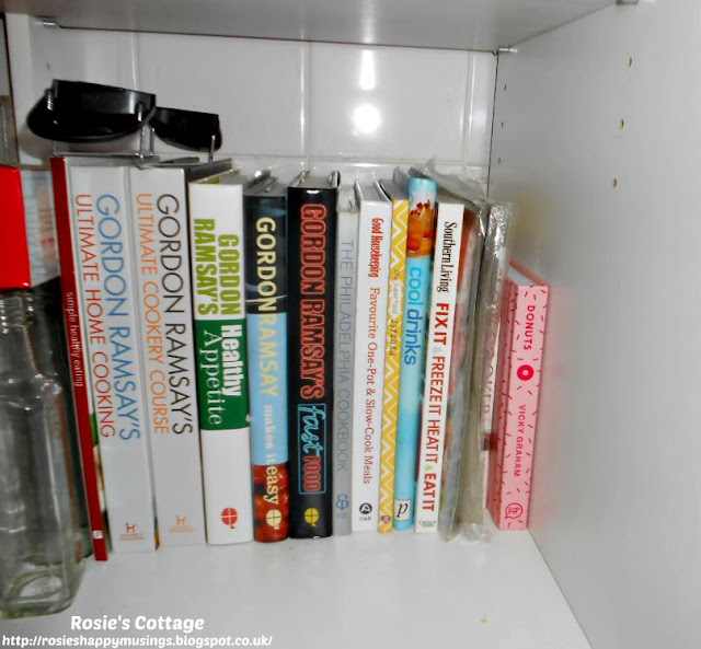 Kitchen Cabinet Re-Organisation: I've used the very back of the lower shelf of this deep cabinet to store my favourite cook books, they're easy to access and it keeps our counter top clear.