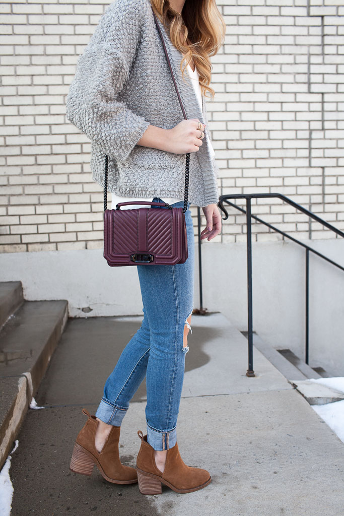 A fuzzy cardigan paired with distressed denim and cutout booties