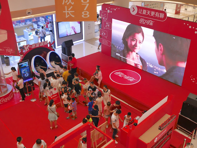 virtual reality ride and large video screen at Coca-Cola promotion in Bengbu, China