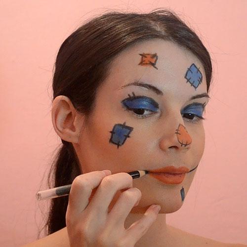 Dibujar boca cosida para maquillaje de espantapájaros