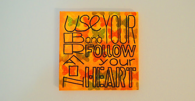 Painting of the words 'use your brain and follow your heart'