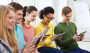 british high school students using phones