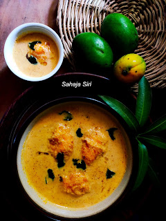 wild mango fruits seasoned in mustard flavored coconut gravy