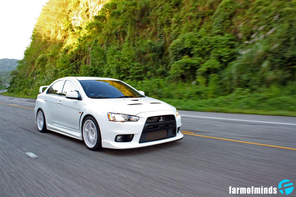 this wicked white evo can be seen tearing up the streets of puerto rico sitting on its hankook evo v12 tires matted to a set of gram lights 57d ceramic