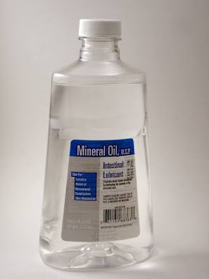 Mineral oil for hair and skin care