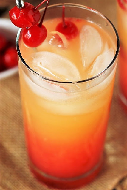 Malibu Sunrise Cocktail with Maraschino Cherries Image