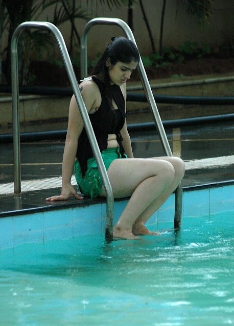 Actress Lucky Sharma Hot Pictures In Green Short and Black Top Navel Queens