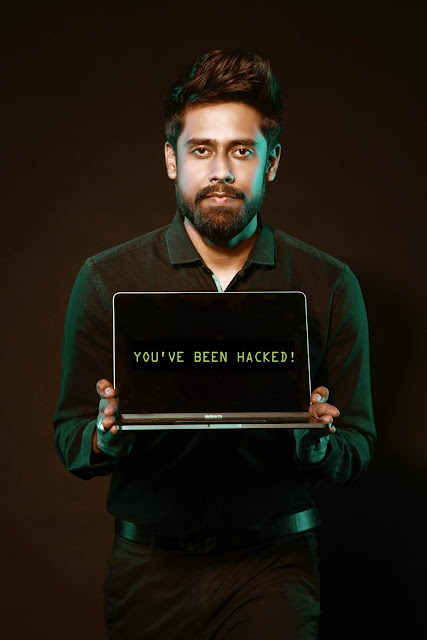 Man holding a computer that is being hacked and data has been stolen