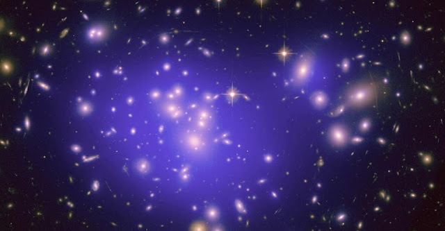 """Dark energy,"" a mysterious force that counters gravity, has been proposed to explain why the universe is expanding at an accelerating rate. Mathematicians at UC Davis and the University of Michigan, Ann Arbor, argue for an alternative. Galaxy cluster image from the Hubble Space Telescope."