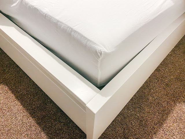 Hovag Mattress with a white bedsheet on top