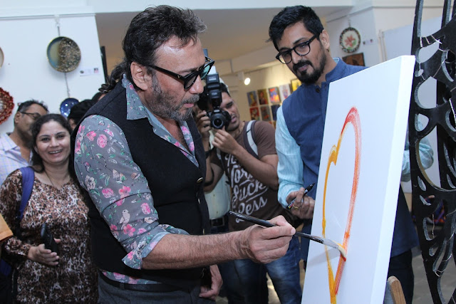 Jackie Shroff trying his hands at painting at Art Trisomy 21, a 2-day art exhibition by specially abled