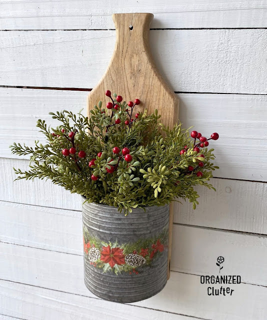 Photo of a cutting board DIY Christmas wall pocket/vase project with decor transfers.
