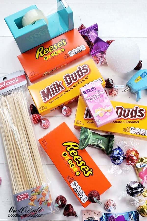 Supplies Needed for Valentine Candy Bouquet: 4 Large Movie Box Candies Wooden Skewers Hot Glue/Gun Tape Candy Styrofoam Ball Piece of cardboard for the base