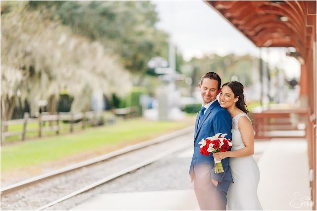 bride and groom photos near train track