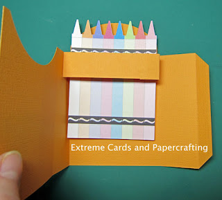 glue first row of crayons to pop up card