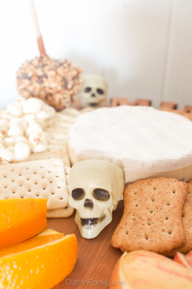 skull decoration on a cheese board