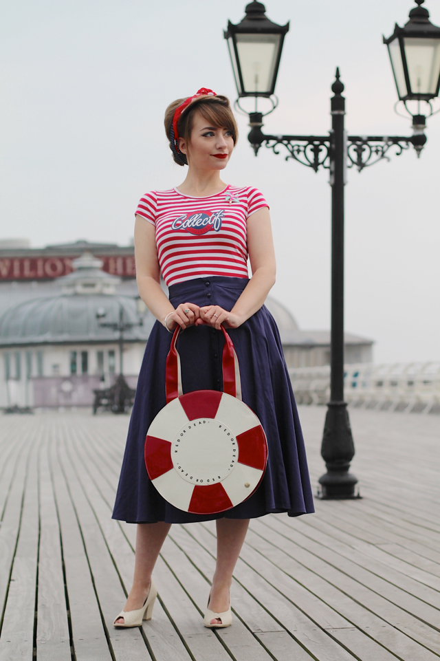 Pin-up style nautical outfit on a pier