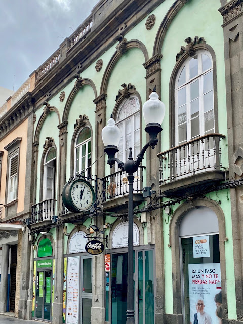 Close up of balconies, street lamps, and clock in Triana, Las Palmas, Gran Canaria, Spain